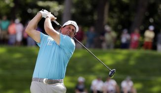 Phil Mickelson watches his tee shot on the 18th hole during the second round of the BMW Championship golf tournament at Medinah Country Club, Friday, Aug. 16, 2019, in Medinah, Ill. (AP Photo/Nam Y. Huh) **FILE**