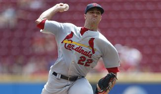 St. Louis Cardinals starting pitcher Jack Flaherty (22) throws against the Cincinnati Reds during the first inning of a baseball game, Sunday, Aug. 18, 2019, in Cincinnati. (AP Photo/Gary Landers)