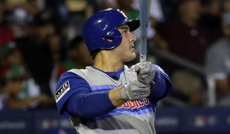 Chicago Cubs' Anthony Rizzo watches his two-run home run off Pittsburgh Pirates relief pitcher Chris Stratton during the fifth inning of the Little League Classic baseball game at Bowman Stadium in Williamsport, Pa., Sunday, Aug. 18, 2019. (AP Photo/Tom E. Puskar)