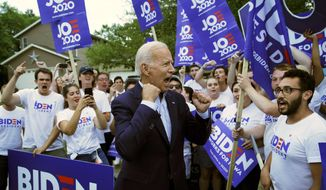 In this Aug. 9, 2019, file photo, former Vice President and Democratic presidential candidate Joe Biden meets with supporters before speaking at the Iowa Democratic Wing Ding at the Surf Ballroom in Clear Lake, Iowa. (AP Photo/John Locher, File)