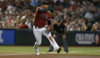 Arizona Diamondbacks third baseman Eduardo Escobar makes an off-balance throw for an out on a ball hit by San Francisco Giants' Buster Posey in the sixth inning of a baseball game, Sunday, Aug. 18, 2019, in Phoenix. (AP Photo/Rick Scuteri)
