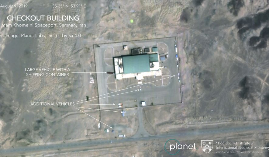 This Aug. 9, 2019, satellite image from Planet Labs Inc., that has been annotated by experts at the James Martin Center for Nonproliferation Studies at Middlebury Institute of International Studies, shows activity at the Imam Khomeini Space Center in Iran's Semnan province. Iran appears to be preparing to attempt another satellite launch after twice failing this year to put one in orbit, despite U.S. accusations that the Islamic Republic's program helps it develop ballistic missiles. (Planet Labs Inc, Middlebury Institute of International Studies via AP)