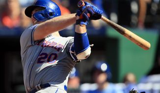 New York Mets' Pete Alonso hits a solo home run off Kansas City Royals relief pitcher Jacob Barnes during the ninth inning of a baseball game at Kauffman Stadium in Kansas City, Mo., Sunday, Aug. 18, 2019. (AP Photo/Orlin Wagner)