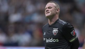 D.C. United's Wayne Rooney reacts after putting a shot over top of the Vancouver Whitecaps' goal during the first half of an MLS soccer match Saturday, Aug. 17, 2019, in Vancouver, British Columbia. (Darryl Dyck/The Canadian Press via AP) **FILE**