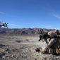 Pfc. Cristian Mejia, javelin gunner, Bravo Company, 1st Battalion, 7th Marine Regiment, and a native of Raleigh, N.C., shoots a javelin missile during a live-fire exercise at Marine Corps Air Ground Combat Center Twentynine Palms, Calif., Jan. 26, 2014. Bravo Co. is dedicated to helicopter operations during their upcoming combat deployment to Afghanistan. The Marines were transported to the range by CH-46 sea knight and CH-53E super sea stallion helicopters. After they landed, the Marines maneuvered through a simulated urban environment with unique shock-absorbent walls. This allowed for them to engage in realistic live-fire training. (U.S. Marine Corps photo by Cpl. Joseph Scanlan / released)
