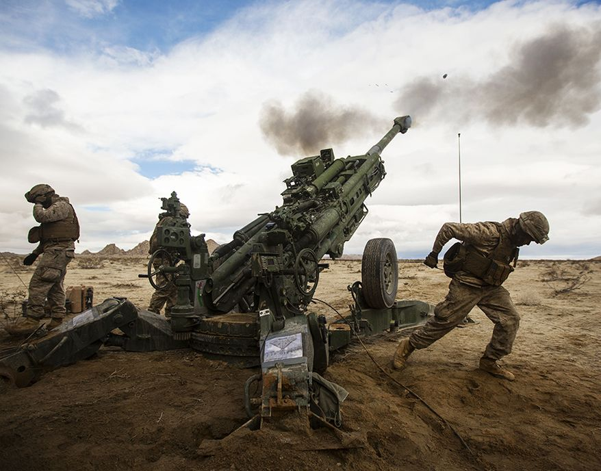 U.S. Marines with Alpha Battery, 1st Battalion, 12th Marines, currently assigned to 3/12, fire the M777-A2 Howitzer down range during Integrated Training Exercise 2-15 at Blacktop Training Area aboard Camp Wilson, Marine Corps Air Ground Combat Center Twentynine Palms, Calif., Jan. 31st, 2015. ITX 2-15, being executed by Special Purpose Marine Air-Ground Task Force 4, is being conducted to enhance the integration and warfighting capability from all elements of the MAGTF. (U.S. Marine Corps photo by Lance Cpl. Aaron S. Patterson/Released)