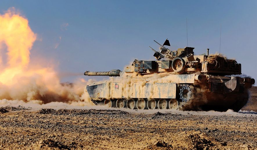 An M1A1 Abrams Main Battle Tank with 24th Marine Expeditionary Unit, fires its 120 mm smoothbore cannon during a live-fire event as part of Exercise Eager Lion 2015 in Jordan, May 9, 2015. Eager Lion is a recurring multinational exercise designed to strengthen military-to-military relationships, increase interoperability between partner nations, and enhance regional security and stability.  (U.S. Marine Corps photo by Sgt. Devin Nichols/Released)