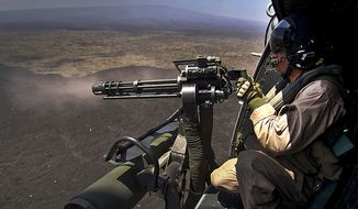 U.S. Marine Corps Cpl. Richard Sippl, UH-1Y Venom, flight crew chief assigned to Marine Light Attack Helicopter Squadron 169 (HMLA-169) fires a 7.62mm GAU-17/A Minigun July 22, 2012, during a live fire combat training mission over the Pohakuloa Training Area, (PTA) Hawaii during Rim of the Pacific (RIMPAC) Exercise 2012. HMLA-169 is part of the aviation combat element of special purpose Marine air-ground task force three. Twenty-two nations, more than 40 ships and submarines, more than 200 aircraft and 25,000 personnel are participating in RIMPAC exercise from Jun. 29 to Aug. 3, in and around the Hawaiian Islands. The world's largest international maritime exercise, RIMPAC provides a unique training opportunity that helps participants foster and sustain the cooperative relationships that are critical to ensuring the safety of sea lanes and security on the worlds oceans. RIMPAC 2012 is the 23rd exercise in the series that began in 1971.  (U.S. Air Force photo by Tech. Sgt. Michael R. Holzworth)