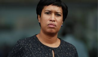 """""""We can build a fairer and more equitable city when we know that our African American and Latino students are achieving at the same level as their white peers,"""" D.C. Mayor Muriel Bowser said. (Associated Press)"""