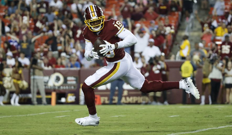 Washington Redskins wide receiver Robert Davis (19) runs with the ball during the first half of an NFL preseason football game against the Cincinnati Bengals, Thursday, Aug. 15, 2019, in Landover, Md. (AP Photo/Alex Brandon)