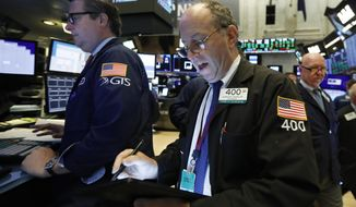 Trader Gordon Chalop, center, works on the floor of the New York Stock Exchange, Monday, Aug. 19, 2019. Technology stocks were leading indexes higher on Wall Street after the U.S. gave Chinese telecom giant Huawei another 90 days to buy equipment from American suppliers. (AP Photo/Richard Drew)