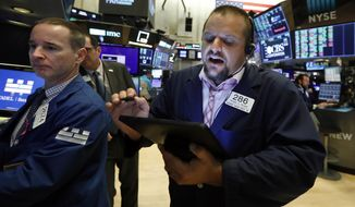 Specialist Stephen Naughton, left, and trader Michael Milano work on the floor of the New York Stock Exchange, Monday, Aug. 19, 2019. Technology stocks were leading indexes higher on Wall Street after the U.S. gave Chinese telecom giant Huawei another 90 days to buy equipment from American suppliers. (AP Photo/Richard Drew)