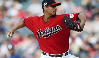 FILE - In this May 25, 2019, file photo, Cleveland Indians starting pitcher Carlos Carrasco delivers against the Tampa Bay Rays during the first inning of a baseball game in Cleveland. Indians right-hander Carrasco has returned to the mound in the minor leagues as he tries to come back after being diagnosed with leukemia. (AP Photo/Ron Schwane, File)