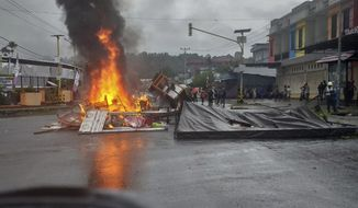 Fires burn during a violent protest in Manokwari, Papua province, Indonesia, Monday, Aug. 19, 2019. The protest was sparked by accusations that Indonesian police who backed by the military, have arrested and insulted dozens of Papuan students in their dormitory in East Java's cities of Surabaya and Malang a day earlier. (AP Photo/Safwan Ashari Raharusun)
