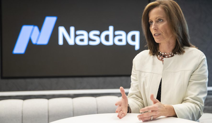 In this Wednesday, July 31, 2019, photo, NASDAQ President and Chief Executive Officer Adena Friedman speaks an interview at NASDAQ headquarters in New York. (AP Photo/Mary Altaffer) **FILE**