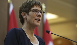 German Defense Minister Annegret Kramp-Karrenbauer speaks at a press conference after meeting with Jordan's Foreign Minister Ayman Safadi, in Amman, Jordan, Monday, August 19, 2019. It was her first trip abroad as Defense Minister. (AP Photo/Raad Adayleh)