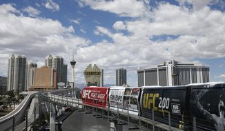 File - In this May 18, 2016, file photo, The Las Vegas monorail leaves a station in Las Vegas. Las Vegas Monorail funding and construction plans may be derailed after Nevada Gov. Steve Sisolak declined to promise state backing for $200 million in tax-exempt bonds. Monorail Co. administrators sought the funds to pay off a recent $13 million loan and to build new stops near the Mandalay Bay resort and the future site of a sphere-shaped arena near The Venetian. (AP Photo/John Locher, File)