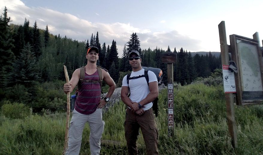 In this July 7, 2017 photo provided by Trevor Reilly, Reilly, left, poses with Marine Pfc. Ali Al-kazahg while hiking in the Eagles Nest Wilderness of the Dillon Ranger District in Colorado. Al-kazahg was apprehended in May 2019 at Offutt Air Force Base. Al-kazahg is in custody in a brig awaiting a military court hearing scheduled for Aug. 21, 2019, on allegations he made threats and tried to bring weapons onto the base in Nebraska while he was on leave. (Trevor Reilly via AP)