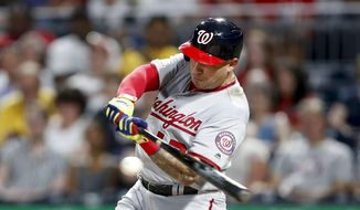 Washington Nationals' Asdrubal Cabrera hits a double driving in two runs in the fourth inning of a baseball game against the Pittsburgh Pirates, Monday, Aug. 19, 2019, in Pittsburgh. (AP Photo/Keith Srakocic)