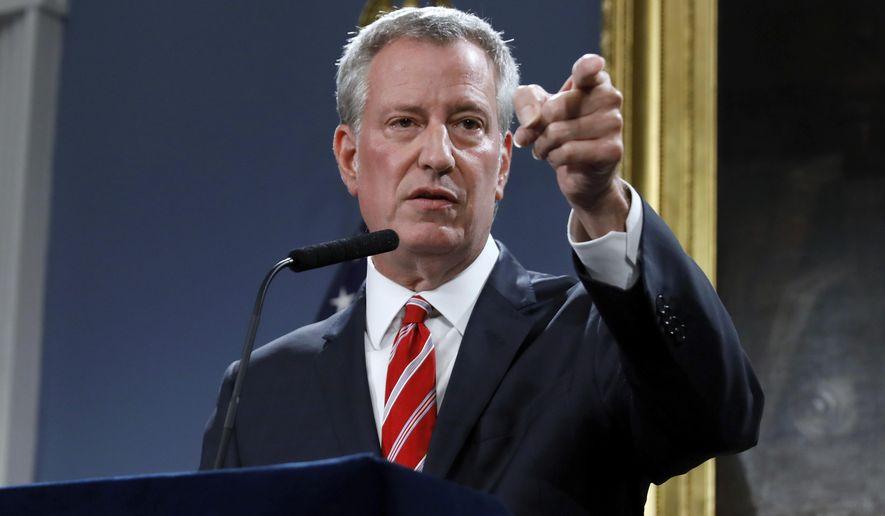 New York Mayor Bill de Blasio calls on a member of the press at City Hall, Monday, Aug. 19, 2019. (AP Photo/Richard Drew)