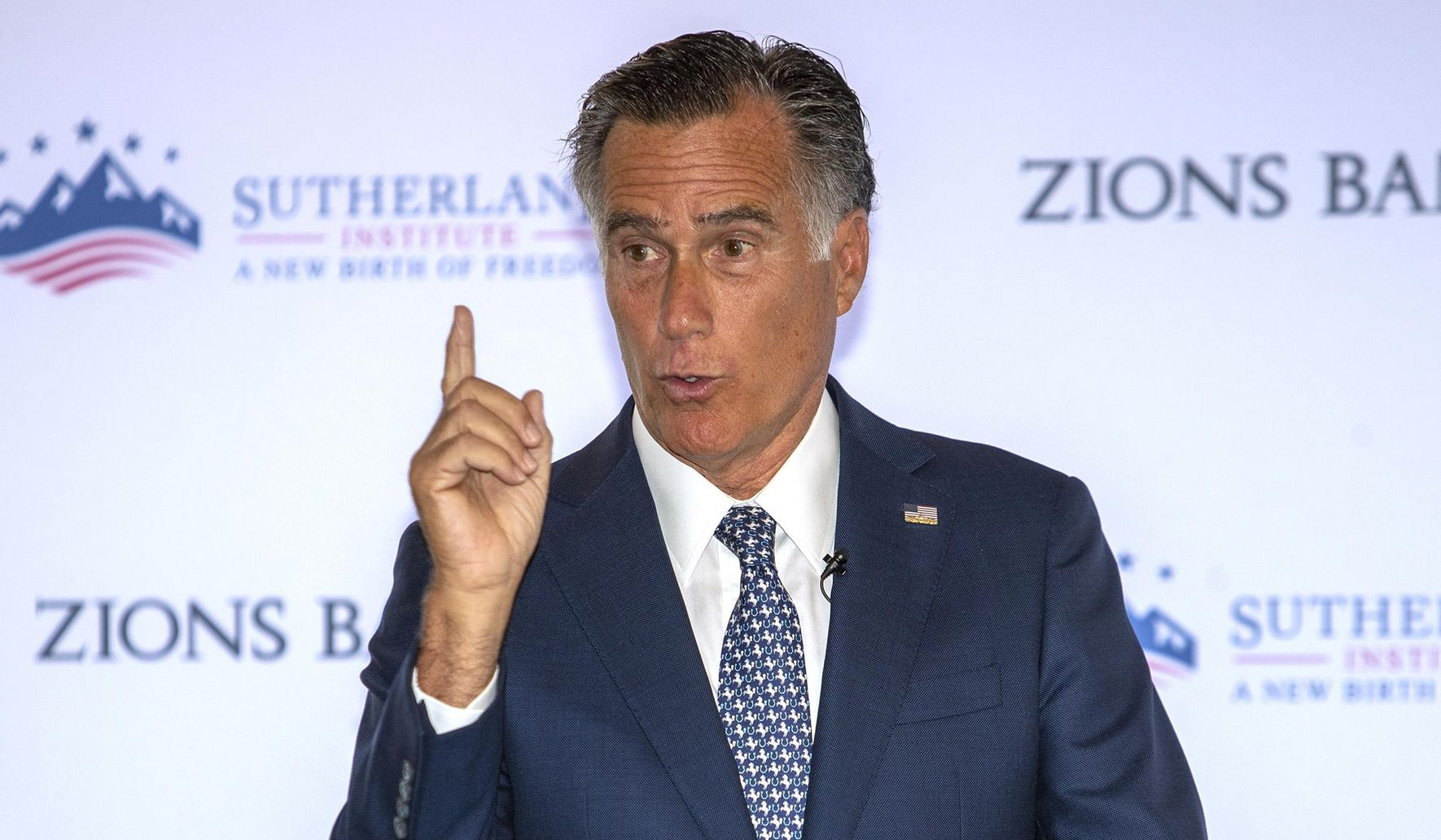 Mitt Romney: Climate change is happening, humans a significant contributor