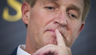 This Oct. 2, 2018, file photo shows U.S. Sen. Jeff Flake in Washington. (AP Photo/Cliff Owen, File)
