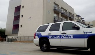 """A Dallas Police vehicle is parked near the South Side Flats apartments on Monday, Sept. 10 2018 photo in Dallas. Authorities say a Dallas police officer said she shot a neighbor whose home she mistakenly entered last week after he ignored her """"verbal commands."""" David Armstrong of the Texas Rangers wrote in an arrest affidavit released Monday that Officer Amber Guyger said she didn't realize she was in the wrong apartment until after she shot 26-year-old Botham Jean and went into the hallway to check the address. Guyger was booked Sunday on a manslaughter charge in Thursday night's killing of Jean and was released on bond.(AP Photo/Ryan Tarinelli) **FILE**"""