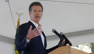 California Gov. Gavin Newsom makes the keynote address at the 23rd Annual Lake Tahoe Summit, Tuesday, at South Lake Tahoe, Calif., Tuesday, Aug. 20, 2019. The summit is a gathering of federal, state and local leaders to discuss the restoration and the sustainability of Lake Tahoe. (AP Photo/Rich Pedroncelli)