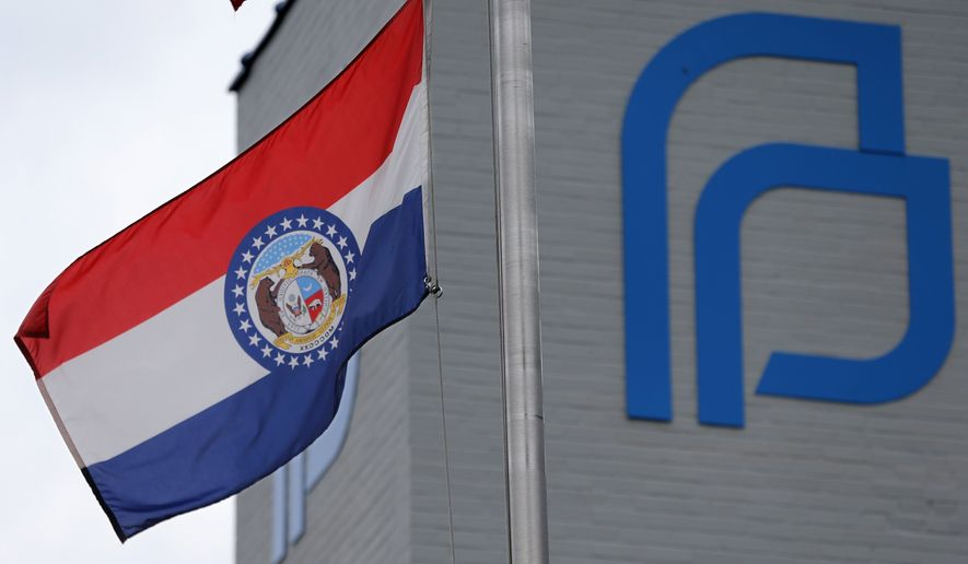 This June 21, 2019, file photo, the Missouri state flag flies outside of Planned Parenthood of the St. Louis Region and Southwest Missouri. (Christian Gooden/St. Louis Post-Dispatch via AP) ** FILE **