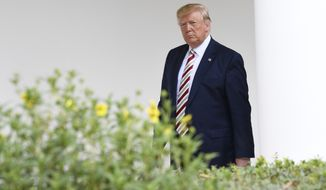 President Donald Trump walks with Romanian President Klaus Iohannis, hidden, along the Colonnade of the White House in Washington, Tuesday, Aug. 20, 2019. (AP Photo/Susan Walsh)