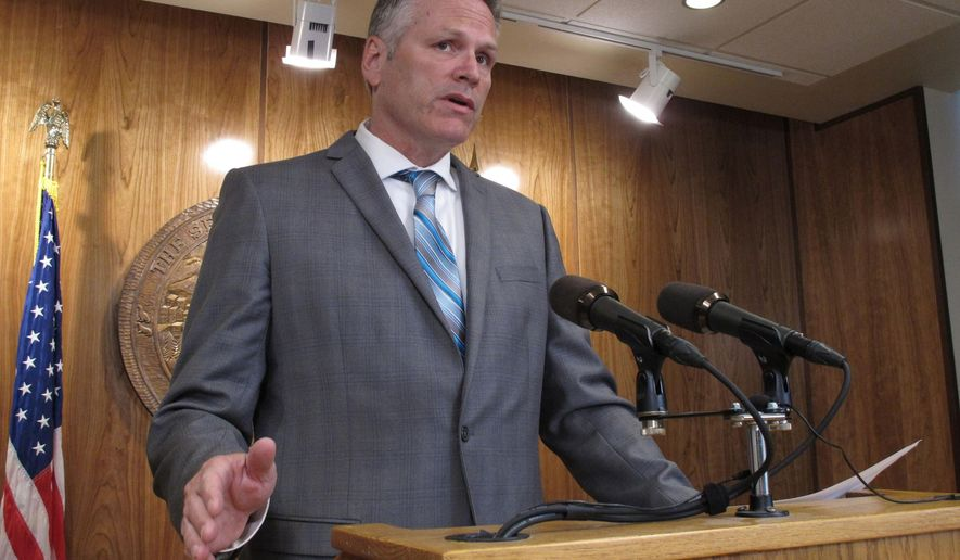FILE - In this June 28, 2019 file photo Alaska Gov. Mike Dunleavy speaks to reporters at the state Capitol in Juneau, Alaska. Dunleavy faced a tricky political decision. He had to decide whether to keep pushing to pay residents a nearly $3,000 check this year from the state's oil-wealth fund or accept a lesser amount approved by lawmakers. The Republican Dunleavy opted for a mix, accepting the lesser amount of about $1,600 but indicating plans for another special session focused on paying what he sees as the remaining balance. Dunleavy, criticized on social media for releasing his statement by video Monday, plans to speak to reporters Tuesday, Aug. 20, 2019. (AP Photo/Becky Bohrer, File)