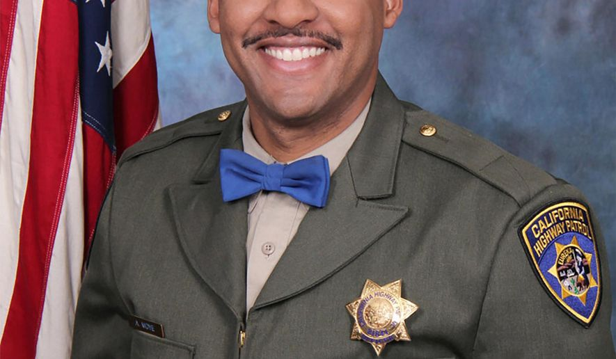 FILE - This undated file photo provided by the California Highway Patrol shows Officer Andre Moye Jr. Members of law enforcement from across the state are expected at a memorial on Tuesday, Aug. 20, 2019, for Moye, who was killed the week before when a motorist he pulled over grabbed a rifle and opened fire during a traffic stop. (David Earhart/Earhart Photography/California Highway Patrol via AP, File)