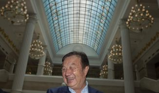 Huawei's founder Ren Zhengfei, reacts during an interview at the Huawei campus in Shenzhen in Southern China's Guangdong province on Tuesday, Aug. 20, 2019. Ren expects no relief from U.S. export curbs due to the political climate in Washington but expresses confidence the company will thrive with its own technology. (AP Photo/Ng Han Guan)