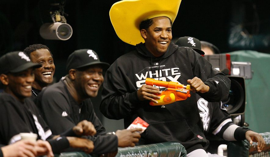 FILE - In this May 31, 2008 file photo, Chicago White Sox pitcher Octavio Dotel, in the cowboy hat, has fun with the Tampa Bay Rays' mascot, during a water pistol fight in a country night promotion prior to a baseball game, in St. Petersburg, Fla. Authorities in the Dominican Republic arrested on Tuesday, Aug. 20, 2019, the former MLB pitcher and are searching for ex-infielder Luis Castillo for their alleged links to a drug-trafficking and money-laundering ring in the Caribbean and United States. (AP Photo/Mike Carlson, File)