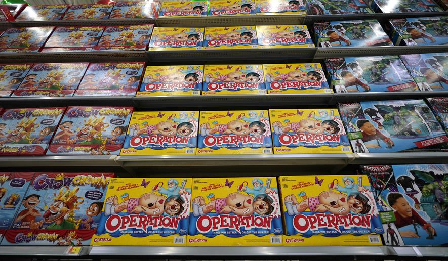 FILE- In this Nov. 9, 2018, file photo Operation made by Hasbro is displayed shelves in the expanded toy section at a Walmart Supercenter in Houston. The toy maker expects said Tuesday, Aug. 20, 2019, that all its packaging for new products to be virtually plastic free by the end of 2022. It plans to stop using plastic bags, elastic bands and the shrink wrap that's usually found around Monopoly, Scrabble and other board games. (AP Photo/David J. Phillip, File)