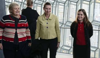 From left, Norway's Prime Minister Erna Solberg, Denmark's Prime Minister Mette Frederiksen and Prime Minister of Iceland Katrin Jakobsdottir arrive at Harpa Concert Hall in Reykjavik, Tuesday Aug. 20, 2019, ahead of the Nordic Prime Ministers meeting. (AP Photo/Egill Bjarnason)