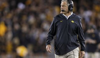 FILE - In this Sept. 22, 2018, file photo, Iowa head coach Kirk Ferentz walks the sidelines during the first half of an NCAA college football game against Wisconsin in Iowa City. The 20th-ranked Hawkeyes are looking to answer questions at running back ahead of their season opener next weekend. (AP Photo/Matthew Putney, File)