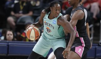 New York Liberty's Tina Charles (31) is defended by Indiana Fever's Teaira McCowan (15) during the first half of a WNBA basketball game, Tuesday, Aug. 20, 2019, in Indianapolis. (AP Photo/Darron Cummings)