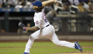 New York Mets relief pitcher Robert Gsellman delivers during the eighth inning of a baseball game against the Washington Nationals, Friday, Aug. 9, 2019, in New York. (AP Photo/Mary Altaffer)