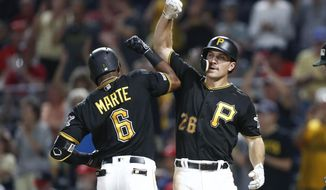 Pittsburgh Pirates' Starling Marte (6) celebrates with Adam Frazier after hitting a three-run home run in the eighth inning of a baseball game, Tuesday, Aug. 20, 2019, in Pittsburgh. The Pirates won 4-1. (AP Photo/Keith Srakocic)