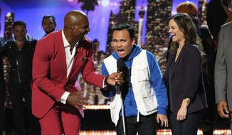 "This Wednesday, Aug. 14, 2019 photo provided by NBC shows host Terry Crews, left, and singer Kodi Lee on the NBC television show, ""America's Got Talent,"" in Los Angeles. With the top two most-watched television shows last week, NBC's ""America's Got Talent'"" continues its dominance when the heat is on. It's the summer's most-watched television series for six summers in a row. (Justin Lubin/NBC via AP)"