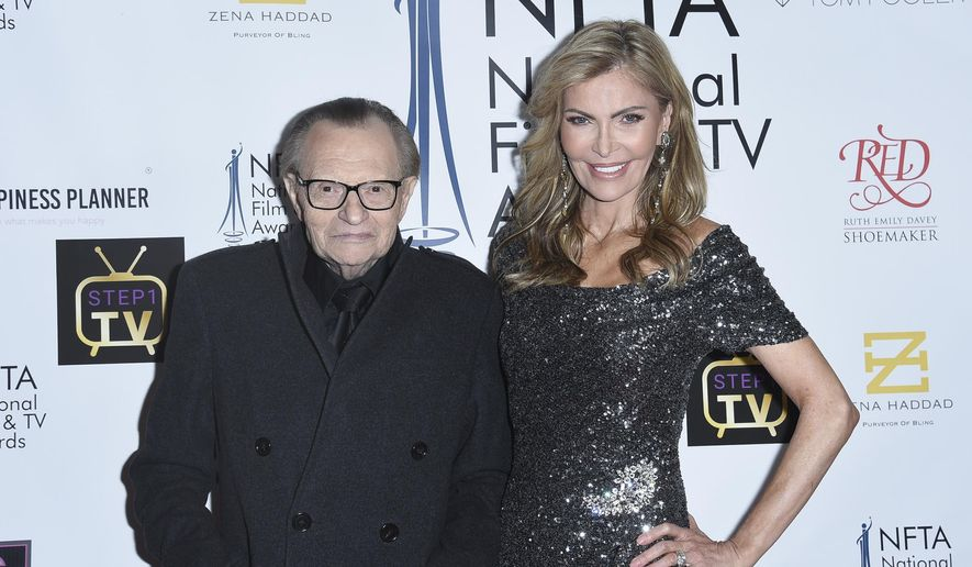 In this Dec. 5, 2018, file photo Larry King, left, and Shawn King attend the 2018 National Film & Television Awards at the Globe Theatre in Los Angeles. King has filed for divorce from his seventh wife, Shawn King, after 22 years. The 85-year-old talk show host filed a petition to end the marriage Tuesday, Aug. 20, 2019, in Los Angeles Superior Court. (Photo by Richard Shotwell/Invision/AP)