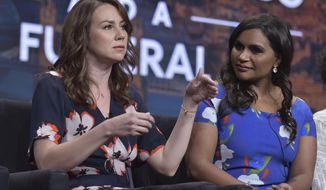 """FILE - In this Friday, July 26, 2019, file photo, showrunner/executive producer Tracey Wigfield, left, and co-creator/executive producer Mindy Kaling participate in Hulu's """"Four Weddings and a Funeral,"""" panel at the Television Critics Association Summer Press Tour in Beverly Hills, Calif. (Photo by Richard Shotwell/Invision/AP, File)"""