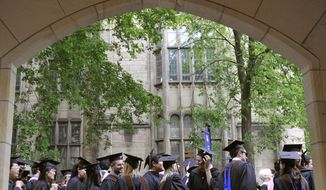 FILE - In this May 24, 2010 file photo, future graduates wait for the procession to begin for commencement at Yale University in New Haven, Conn. An investigation has concluded that Yale University professor Eugene Redmond sexually assaulted five students at a research facility on the Caribbean island of St. Kitts and committed sexual misconduct against at least eight others. The report by former Connecticut U.S. Attorney Deirdre Daly was released Tuesday, Aug. 20, 2019. (AP Photo/Jessica Hill, File)
