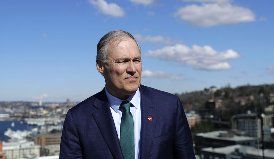 In this March 1, 2019, file photo, Washington Gov. Jay Inslee stands on an outdoor patio as he takes part in media interviews in Seattle after announcing earlier in the day that he will seek the 2020 Democratic presidential nomination. Inslee, who made fighting climate change the central theme of his presidential campaign, announced Wednesday night, Aug. 21, 2019, that he is ending his bid for the 2020 Democratic nomination. Inslee announced his decision on MSNBC, saying it's become clear that he won't win. (AP Photo/Ted S. Warren)