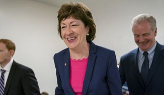 In this June 18, 2019, file photo, Sen. Susan Collins, R-Maine, center, arrives at the Capitol in Washington to extend her perfect Senate voting record to 7,000. National money is already flowing into Maines 2020 Senate race, offering the latest indicator that incumbent Collins faces a stiff reelection fight.  Maine House Speaker Sara Gideon, D-Freeport, is challenging Collins in the 2020 election. (AP Photo/J. Scott Applewhite, File)