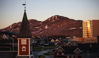 "In this Monday, July. 31, 2017, file photo the sun sets over Nuuk, Greenland. A spokeswoman for Denmark's royal palace says U.S. President Donald Trump's decision to postpone a visit to Denmark next month was ""a surprise."" Trump announced his decision by tweet after the Danish prime minister dismissed the notion of selling Greenland to the U.S. as ""an absurd discussion."" (AP Photo/David Goldman, File)"