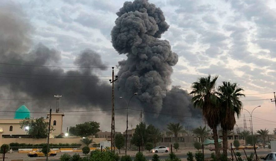 Plumes of smoke rise after an explosion at a military base southwest of Baghdad, Iraq. A fact-finding committee appointed by the Iraqi government to investigate a massive munitions depot explosion near the capital Baghdad has concluded that the blast was the result of a drone strike. A copy of the report was obtained by The Associated Press Wednesday, Aug. 21, 2019. (AP Photo/Loay Hameed, File)
