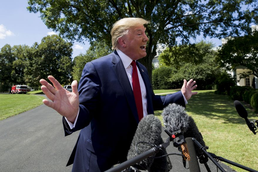 President Donald Trump speaks with reporters before departing on Marine One on the South Lawn of the White House, Wednesday, Aug. 21, 2019, in Washington. Trump is headed to Kentucky. (AP Photo/Alex Brandon)