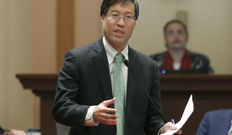 FILE - In this May 22, 2019, file photo, State Sen. Richard Pan, D-Sacramento, calls on lawmakers to approve his measure to toughen the rules for vaccination exemptions in Sacramento, Calif. An anti-vaccine activist has been cited for assault after pushing Pan on a sidewalk near the Capitol. Kenneth Austin Bennett livestreamed the confrontation on his Facebook page. It shows him shoving Pan in the back after questioning him on vaccinations. The Sacramento Police Department say they cited Bennett on a misdemeanor assault charge then released him. (AP Photo/Rich Pedroncelli, File)
